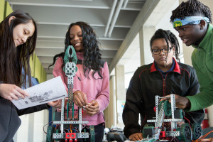 Ninth-grade students assemble robots at MC2 STEM High School. Courtesy of Allison Shelley/The Verbatim Agency for American Education: Images of Teachers and Students in Action.