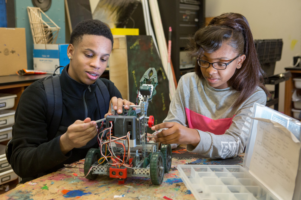 Ninth-grade students assemble a robot in an engineering class at MC2 STEM High School. Photo by Allison Shelley/The Verbatim Agency for American Education: Images of Teachers and Students in Action