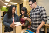 A teacher helps two engineering students build a butterfly house.  Photo by Allison Shelley/The Verbatim Agency for American Education: Images of Teachers and Students in Action